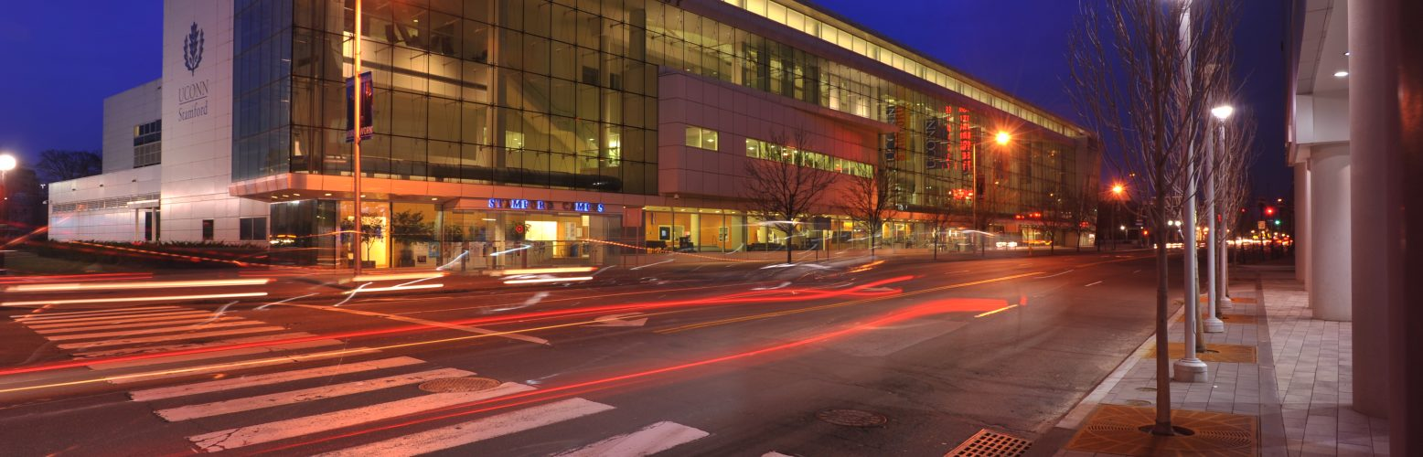 An exterior view of the Stamford Campus at night